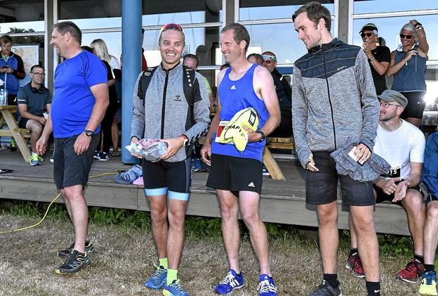 Vinderne af 10 km: 1. Jon Pedersen (midten) 38.24 min. 2. Christian Broksø, 38.31, 3. Kasper Boamah, 39.26 min. Foto: Ole Iversen