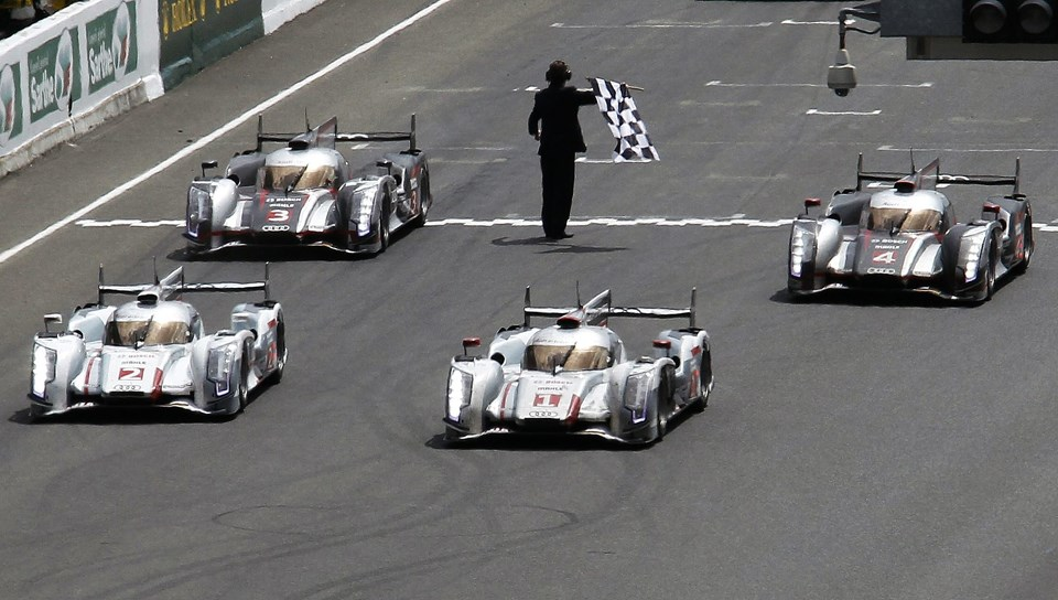Andre Lotterer of Germany driving the Audi R18 E-Tron Quattro Number 1 crosses the finish line at the Le Mans 24-hour sportscar race in Le Mans, central France June 17, 2012. The Audi Number 1 was also driven by Benoit Treluyer of France, and Marcel Fassler of Switzerland. REUTERS/Regis Duvignau (FRANCE - Tags: SPORT MOTORSPORT)