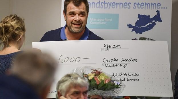 Carsten Svendsen modtog prisen som årets landsbyildsjæl, da der mandag aften var årsmøde i ?landdistriktsrådet.   Foto: Michael Koch