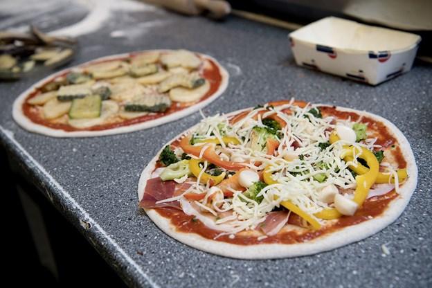 Osten på de fedtfattige pizzaer indeholder kun 15 procent fedt.