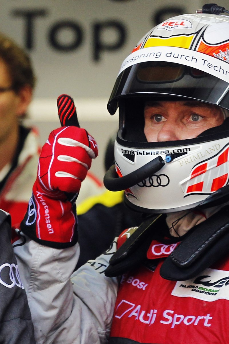 Denmark's Tom Kristensen reacts in the pit lane near his Audi R18 E-Tron Quattro Number 2 during the Le Mans 24-hour sportscar race in Le Mans, central France June 17, 2012. Audi Number 2 is also driven by Britain's Allan McNish and Italy's Rinaldo Capello. REUTERS/Stephane Mahe (FRANCE - Tags: SPORT MOTORSPORT)