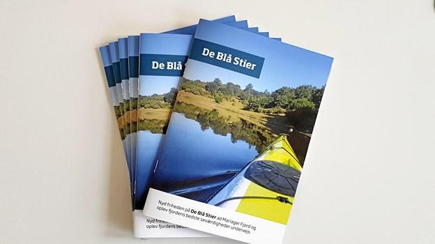 """Den nye folder, """"De Blå Stier"""", har nærmest karakter af en helt lille bog og vil i fremtiden kunne afhentes gratis på Mariagerfjord Kommunes biblioteker og turistbureauer. Privatfoto"""