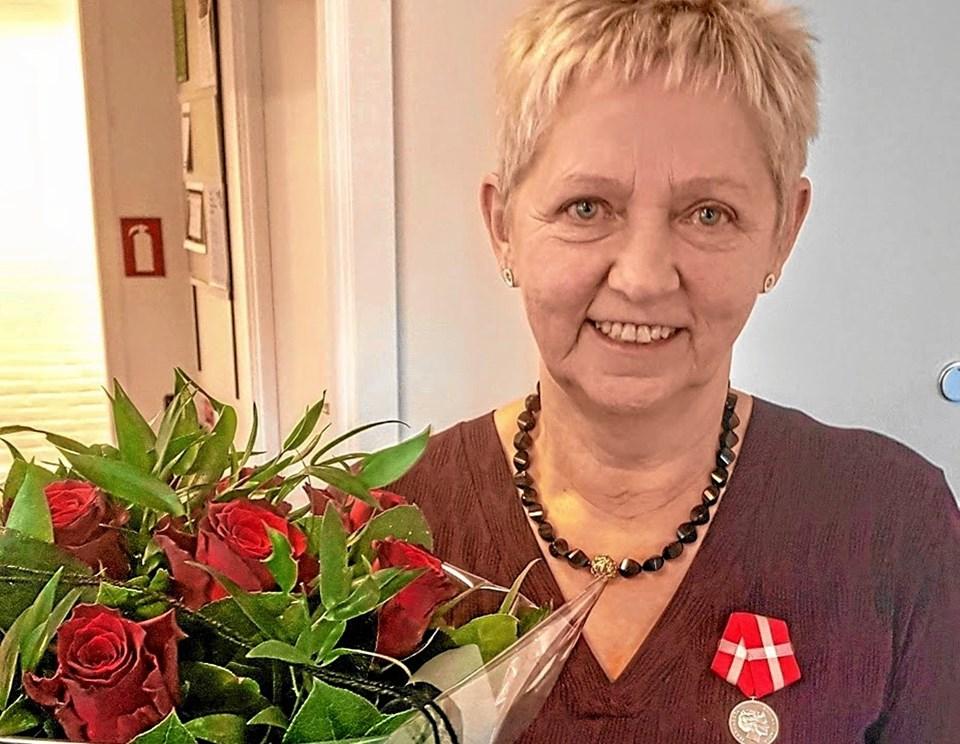 Medalje og blomster. Foto: Karl Erik Hansen
