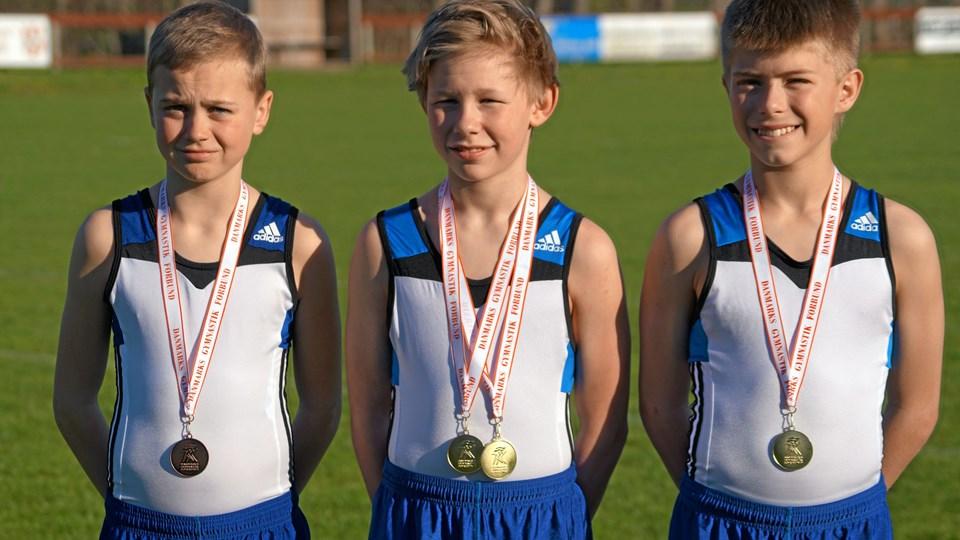 Lukas Grøntved Lauritsen, tv. vandt bronze i U12, Carl Emil Jernov, i midten, vandt to guldmedaljer i U14 og Peter Sørensen, th., vandt en guldmedalje i U14.Privatfoto