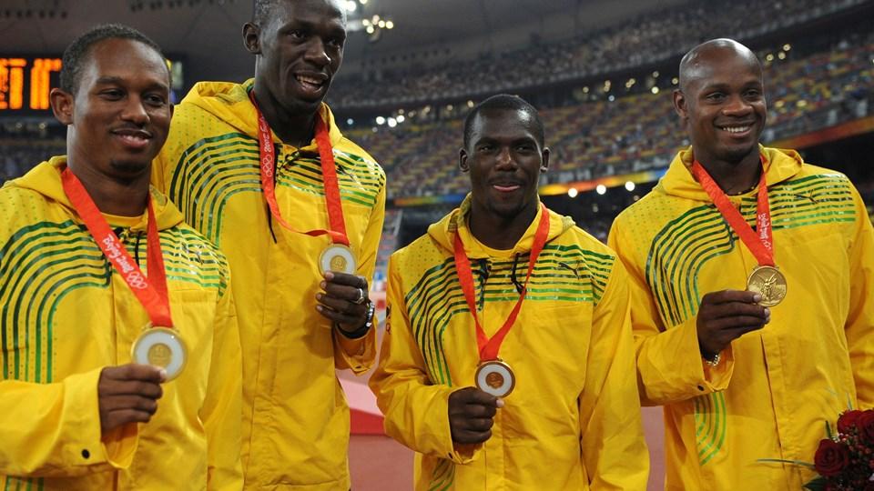 Smilene var store, da Jamaica i 2008 vandt OL-guld i 4 x 100 meter ved OL i Beijing. Torsdag besluttede CAS, at guldmedaljerne endegyldigt er frataget Usain Bolt og co. Foto: Fabrice Coffrini/arkiv/Ritzau Scanpix