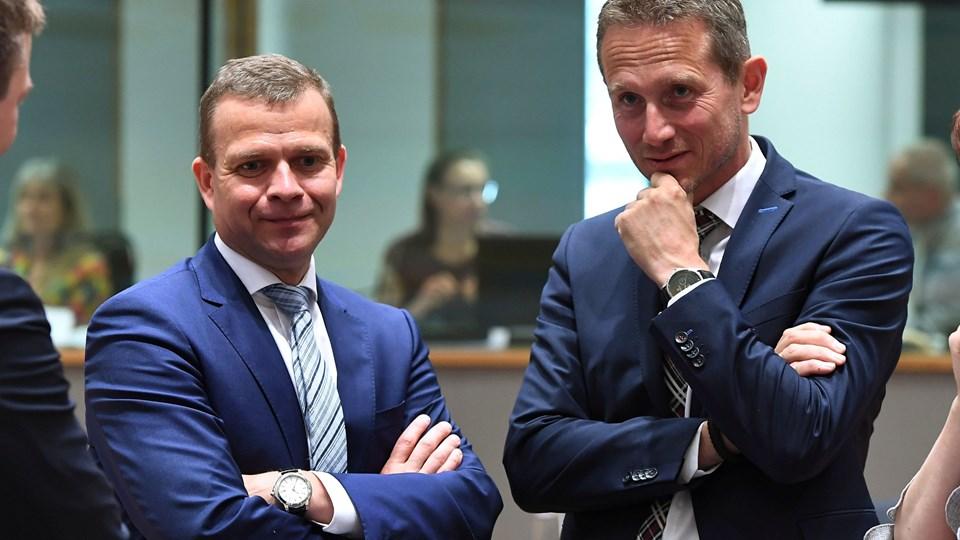 Finansministrene fra Finland og Danmark, Petteri Orpo og Kristian Jensen, udtrykte før et eurogruppemøde i Bruxelles bekymring over Italiens budgetudspil, der vil øge underskuddet markant. Foto: Emmanuel Dunand/arkiv/Ritzau Scanpix