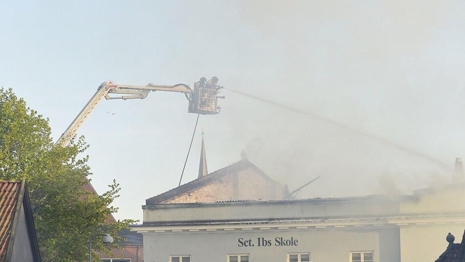 Branden opstod i en bygning, der er tilknyttet Sct. Ibs Skole i Kildegade i Horsens. Selve skolen er uskadt. Foto: Scanpix/Mads Dalegaard