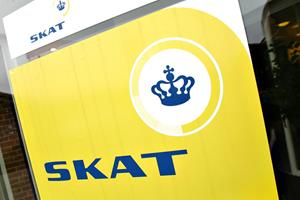 Topskat: Danskerne slipper billigere i skat næste år